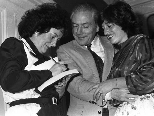 June Levine autographing a copy of her book, Sisters, for Gay Byrne at a reception in Dublin to mark its publication, watched by her daughter, Diane, to whom the book was dedicated. Photograph: Jimmy McCormack/The Irish Times
