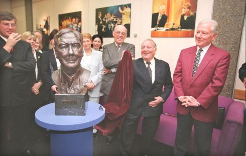 Prof Austin Darragh, founder president of the Irish Cancer Society unveils a bronze of Gay Byrne (right) in 2002 at the RTÉ Television Studios in Donnybrook to mark Gay's voluntary work as campaign chairman.  Photograph: The Irish Times