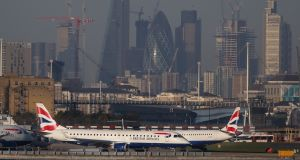British Airways airplanes on the runway at London City Airport   with the  City of London in the background. Photograph: Daniel Leal-Olivas/ AFP/Getty Images