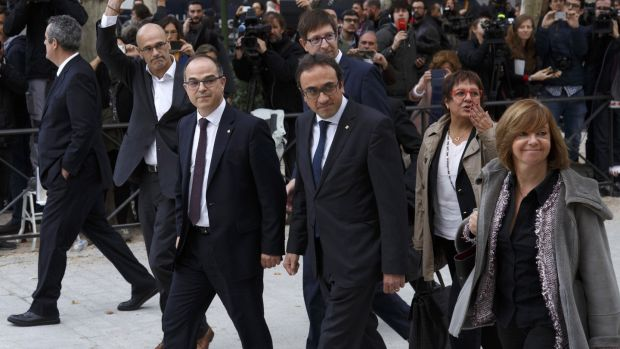 Former members of the Catalan government (left to right): Joaquin Forn, Raul Romeva, Josep Rull, Carles Mundo, Jordi Turull, Dolors Bassa and Meritxel Borras arrive at Spain's National High Court today in Madrid, Spain. Along with ousted president Carles Puigdemont they were ordered to appear on charges of rebellion, sedition and misuse of public funds following the unilateral declaration of independence. Photograph: Pablo Blazquez Dominguez/Getty Images