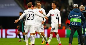 Christian Eriksen, Fernando Llorente and Dele Alli of Spurs celebrate  their  Champions League win over Real Madrid. Photograph:  Clive Rose/Getty Images