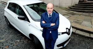 Minister for Climate Action Denis Naughten at the handover of his new 100% electric car. Last month, he flew to Brussels to demand that the State be allowed to opt out of even the basic emissions commitments we had already signed up to. File photograph: Maxwell Photography
