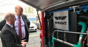 British  transport secretary Chris Grayling with head of product development for low-emissions buses at Wrightbus, Jim Morrison, during a visit to the  Wrightbus factory in Ballymena. Photograph: Department for Transport/PA Wire