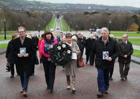 THE DISAPPEARED: Oliver McVeigh (right) and his sister Dympna Kerr (second left), brother and sister of Columba McVeigh, along with Marie Lynskey, niece of Joe Lynskey, and Mike Pywell, carrying a photograph of Robert Nairac, during the 11th annual 'Silent Walk for the Disappeared' at Stormont, Belfast. The three men's remains are yet to be recovered after going missing during the Troubles. Photograph: Brian Lawless/PA Wire