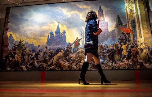 "REVOLUTIONARY ART: A woman walks in front of a painting called ""The storm of the Kremlin"" by Soviet painter Pavel Sokolov-Skalya during a media preview of ""The Energy of a Dream"" exhibition at the State Historical Museum in Moscow. The exhibition marks the centenary of the Bolshevik Revolution. Photograph: Mladen Antonov/AFP/Getty Images"