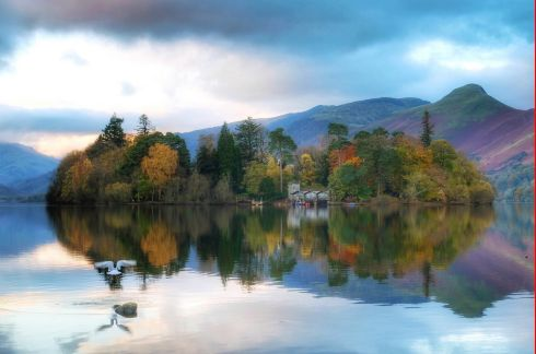 PERFECT DAY: Autumn colours reflected in Derwentwater at Keswick in Cumbria. Photograph: Owen Humphreys/PA Wire