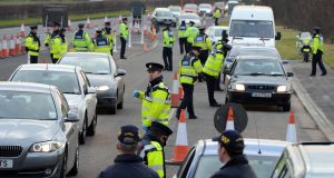 Gardaí inspect vehicles at a checkpoint. Government Ministers insisted disciplinary action would be taken against individual gardaí if evidence of wrongdoing had occurred. File photograph: Eric Luke/The Irish Times