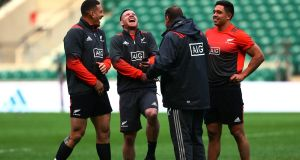 New Zealand head coach Steve Hansen shares a joke with with his players during the Captain's Run at Twickenham Stadium ahead of the game against the Barbarians on Saturday. Photograph:  Jordan Mansfield/Getty Images