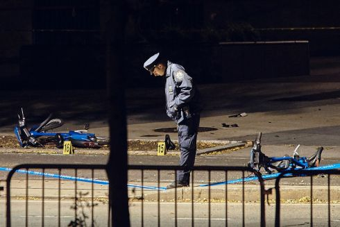 NEW YORK ATTACK: A police officer stands guard on a Manhattan cycle path where eight people died in a terror attack in which Sayfullo Saipov is believed to have ploughed his pickup truck into passersby. Photograph: Andres Kudacki/AP