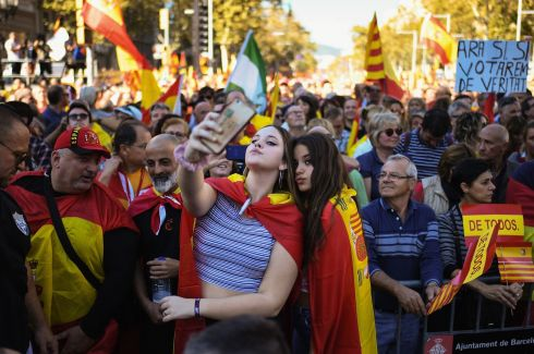 SELFIE FOR SPAIN: Two girls photograph themselves at a pro-unity rally in Barcelona after the Catalan parliament voted to split from Madrid. The Spanish government responded by imposing direct rule and dissolving the regional assembly. Photograph: Jeff J Mitchell/Getty