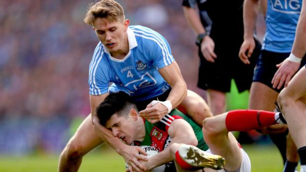 Dublin's Michael Fitzsimons in action against Conor Loftus of Mayo during the All-Ireland final. Photograph: James Crombie/Inpho