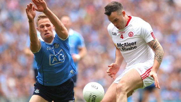 Dublin's Paul Mannion attempts to block Cathal McCarron of Tyrone during the All-Ireland semi-final at Croke Park. Photograph: James Crombie/Inpho