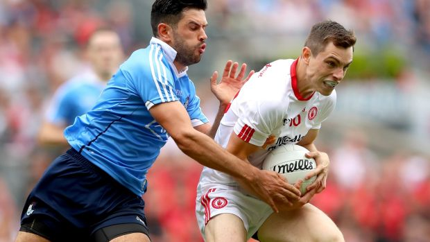 Dublin's Cian O'Sullivan in action against and David Mulgrew of Tyrone. Photograph: James Crombie/Inpho