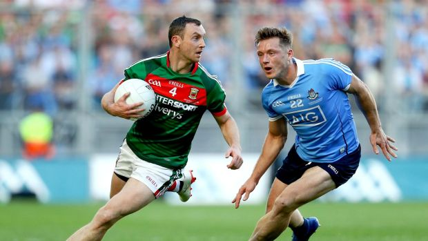 Mayo's Keith Higgins gets away from Paul Flynn of Dublin during the All-Ireland final. Photograph: Tommy Dickson/Inpho