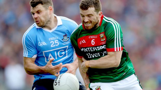 Mayo's Chris Barrett challenges Dublin's Kevin McManamon during the All-Ireland final. Photograph: James Crombie/Inpho