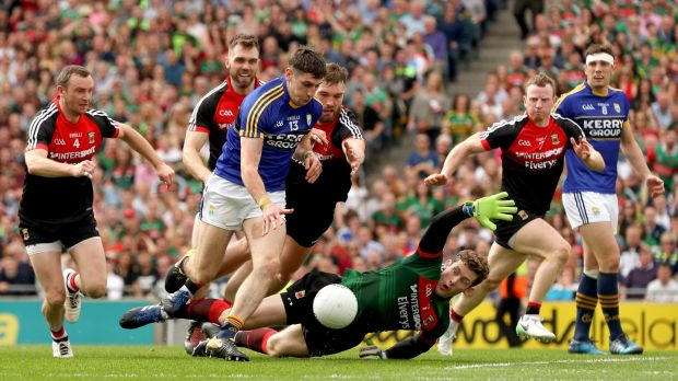 Mayo goalkeeper David Clarke attempts to block Kerry's Paul Geaney during the All-Ireland semi-final replay at Croke Park. Photograph: James Crombie/Inpho