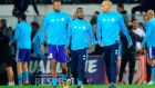 Marseille's French defender Patrice Evra  is escorted off the pitch by team-mates  Rolando and  Doria after an argument with supporters before the start of the  Europa League match against Vitoria SC  in Guimaraes, Portugal. Photograph:   Miguel Riopa/AFP/Getty Images