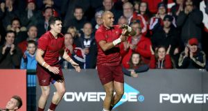 Munster's Simon Zebo celebrates scoring their second try  in the Guinness Pro 14 game against Dragons at Musgrave Park. Photograph: Ryan Byrne/Inpho