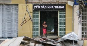 A man stands at a house damaged by typhoon Damrey, in Nha Trang, Khanh Hoa. Photograph: EPA