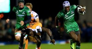 Connacht's Niyi Adeolokun goes past Luther Obi of Toyota Cheetahs to score his side's opening try during the Guinness Pro 14 game at the Sportsground in Galway. Photograph: James Crombie/Inpho