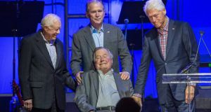 Former US presidents Jimmy Carter, George HW Bush, George W Bush, and Bill Clinton attending the Hurricane Relief concert in College Station, Texas. File photograph:  Jim Chapin/AFP/Getty Images