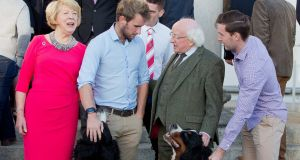 President Michael D. Higgins and his wife Sabina Higgins meet rowers Gary O'Donovan (L) and Paul O'Donovan (R). Photograph: The Irish Times