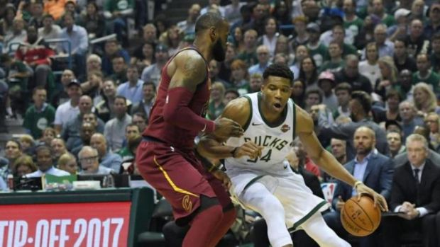 Giannis Antetokounmpo of the Milwaukee Bucks and LeBron James of the Cleveland Cavaliers during a game in Milwaukee in October. Photograph: Stacy Revere/Getty Images