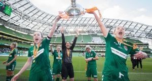Cork City's Ciara McNamara and Mary Barrett celebrate with the trophy after the game. Photograph: Oisin Keniry/Inpho