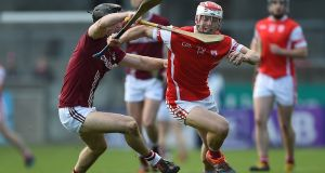 Cuala's Con O'Callaghan breaks away from the challenge of  Dicksboro's Evan Cody during the  AIB  Leinster SHC quarter-final at  Parnell Park. Photograph: Tommy Grealy/Inpho