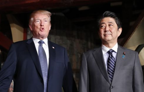TRUMP ON TOUR: US president Donald Trump with Shinzo Abe, Japan's prime minister, at the Uka-Tei restaurant in Tokyo, Japan. Trump warned states against challenging the US as he rallied American troops in Japan on the first stop of his 11-day tour of Asia. Photograph: Kim Kyung-Hoon/Bloomberg