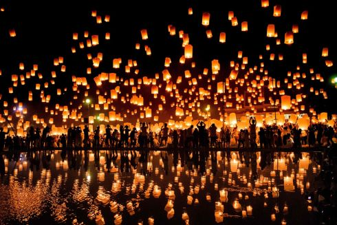 YEE PENG FESTIVAL: A crowd releases Chinese lanterns into the air as they celebrate the Yee Peng festival, also known as the festival of lights, in Chiang Mai, Thailand. Photograph: Roberto Schmidt/AFP/Getty Images