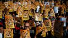 "Catalan rally: demonstrators in Barcelona hold banners reading ""Freedom for the Political Prisoners. Photograph: Manu Fernandez/AP Photo"