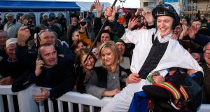 Colin Keane at Naas celebrating his 100th winner of the year on board Warnaq. Photograph:  James Crombie/Inpho
