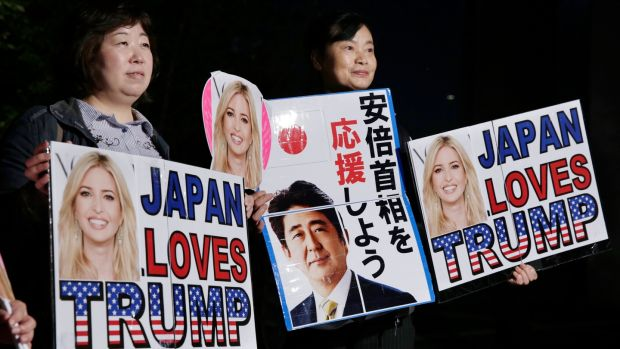 "Big in Japan: fans wait for Ivanka Trump outside a restaurant in Tokyo. The Japanese characters in the centre read ""Support Prime Minister Abe"". Photograph: Kimimasa Mayama/EPA"