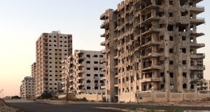Buildings in al-Waer, Homs, damaged in the Syrian war, stand alongside others that have emerged unscathed to date. Photograph: Michael Jansen