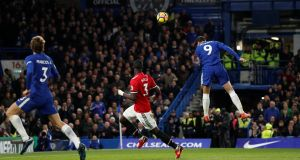 Chelsea's Alvaro Morata heads the only goal of the game at Stamford Bridge. Photograph: John Sibley/Reuters