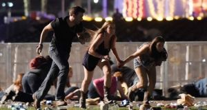 People run from the Route 91 Harvest country music festival after a shooting in Las Vegas, Nevada in October 2017. Photograph: David Becker/Getty Images