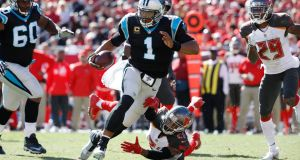 Cam Newton of the Carolina Panthers runs for a 20-yard gain in the fourth quarter against the Tampa Bay Buccaneers at Raymond James Stadium. Photograph: Joe Robbins/Getty Images
