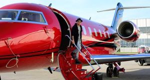 Lewis Hamilton arriving in Montreal for the Canadian Grand Prix on a bright red jet.