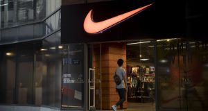 A man enters a Nike shop  in Bangkok, Thailand. File photographer: Brent Lewin/Bloomberg