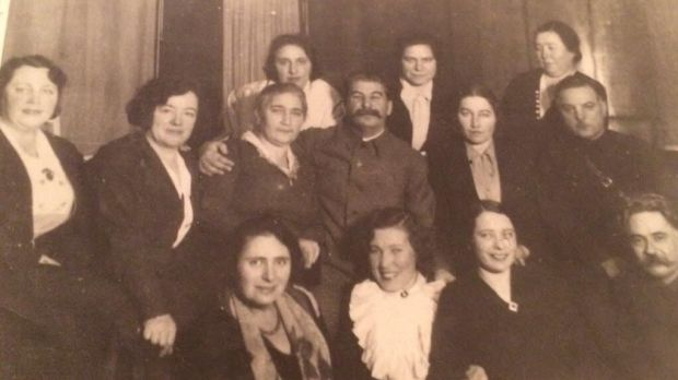 Stalin with Elena Alliloueva-Lorigan's great-grandmother Eugeniya (bottom row wearing white top. Stalin is standing directly behind her).