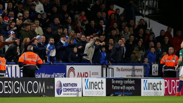 Huddersfield Town fans gesture towards McClean. Photo: Getty Images