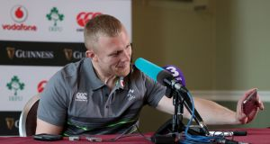 Keith Earls checks a journalist's phone as it goes off during the press conference ahead of Ireland's November Test series. Photo: Dan Sheridan/Inpho