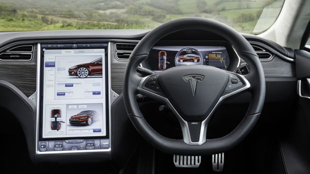 Inside the car, the dominant feature remains Tesla's enormous touchscreen.