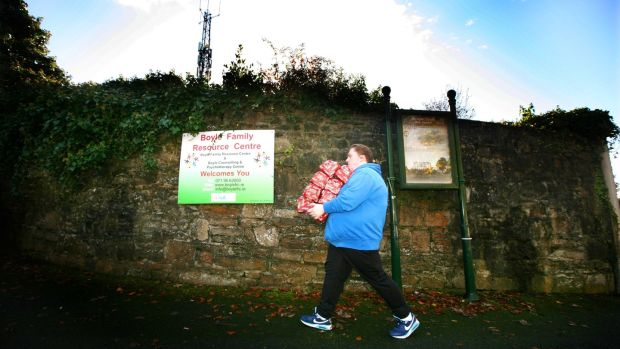 Volunteer Christine Murphy brings newly donated food to the centre in Boyle. Photograph: Brian Farrell