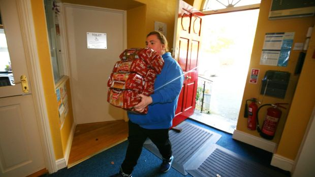 Volunteer Christine Murphy arrives with stock donated by a local supermarket to the Boyle Family Resource Centre. Photograph: Brian Farrell