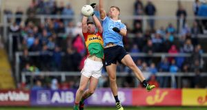 Carlow's Mark Rennick and Dublin's Paul Mannion during their  Leinster quarter-final at O'Moore Park, Portlaoise, in June. Photograph: Tommy Dickson/Inpho