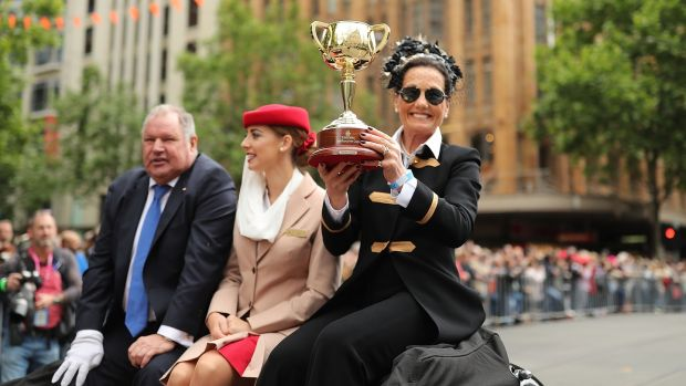 Elliott holds aloft the Melbourne Cup during the parade. Photo: Mark Metcalfe/Getty Images