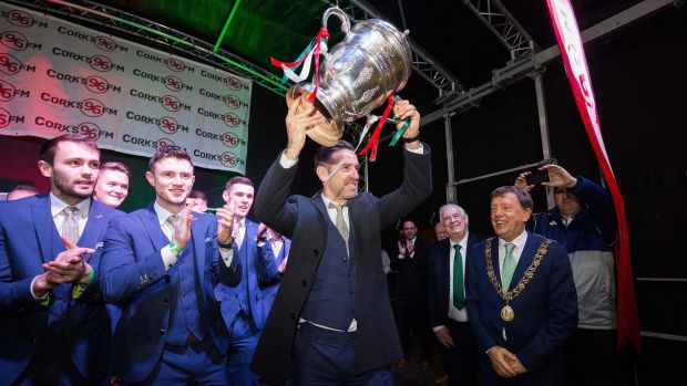 Alan Bennett lifts the FAI Cup in front of thousands of fans who attended the Cork City FC's homecoming on Monday evening. Photograph: Oisin Keniry/Inpho
