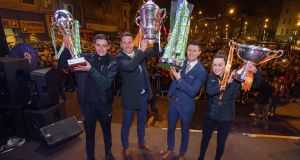 Cork City captains Jack O'Sullivan Byrne (under-17), Alan Bennett, John Dunleavy and Ciara McNamara were greeted by thousands of fans on Monday night. Photograph: Oisin Keniry/Inpho